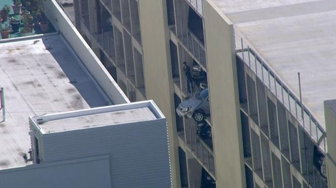 Car Dangles From Parking Structure
